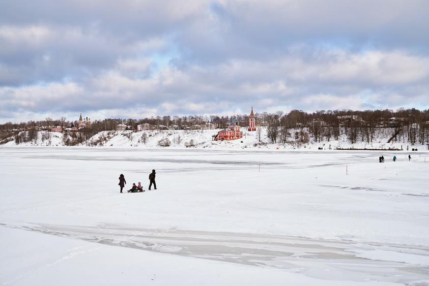 Family crossing frozen Volga River, Tutayev