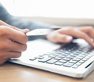 hands-holding-credit-card-typing-laptop.
