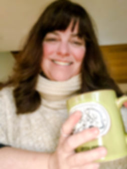 Image of Photographer Laura Dooley with a coffee