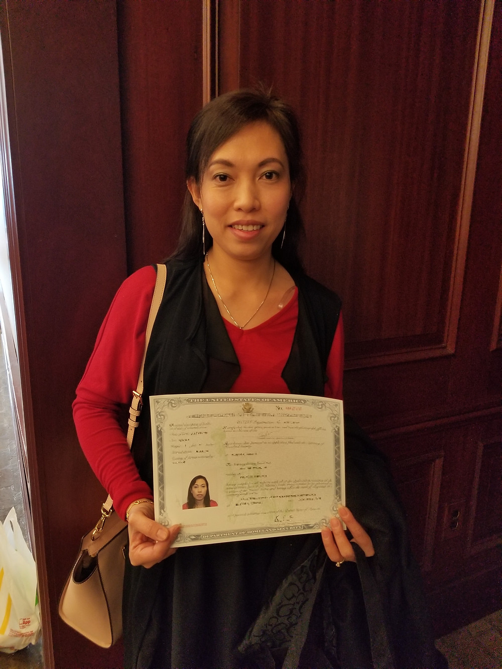 Son with her Certificate of Naturalization