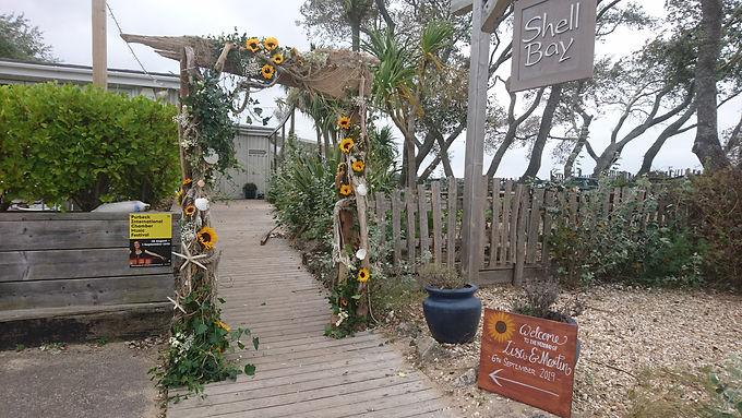 Arch - Driftwood Seaside with Sunflower Sprays