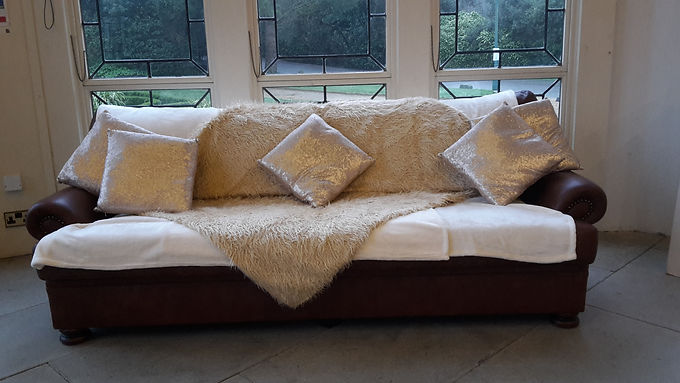 Sofa Brown leather with cushions and throw