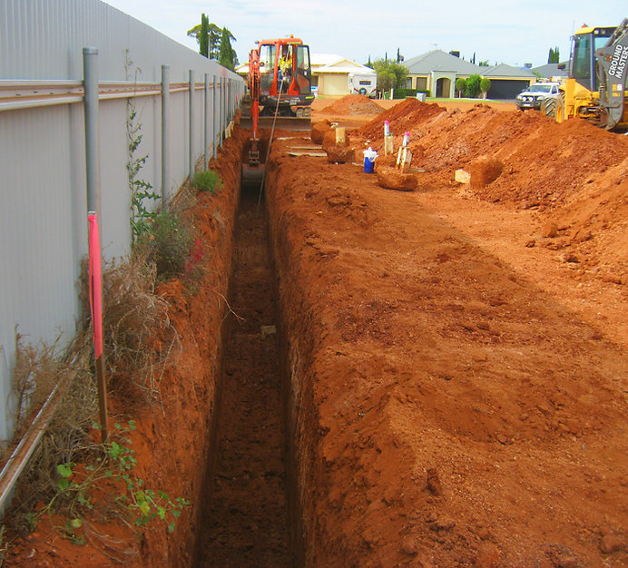 Ground Masters Domestic Earthworks for house construcion excavator digging trench for electical wiring and plumbing backhoe light vehicle
