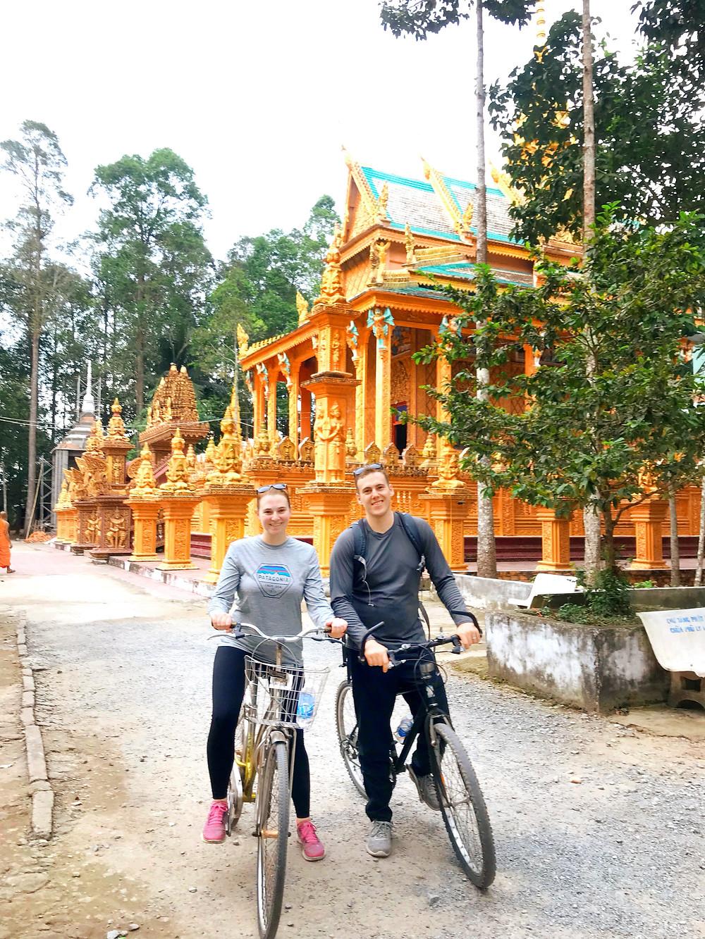 Biking through neighborhoods in the Mekong Delta
