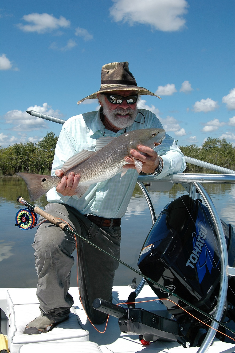 Flip Pallot posing with a sight fished redfish from last fall.  Cooler weather makes redfish happy and provides plenty of chance to sight fish them.