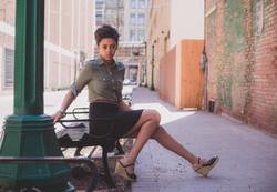Woman modeling on downtown street