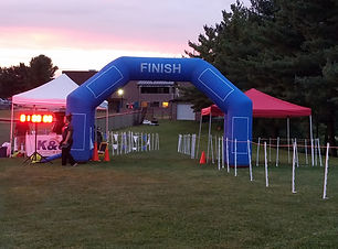 Image of a finish line setup with a tent and balloon.
