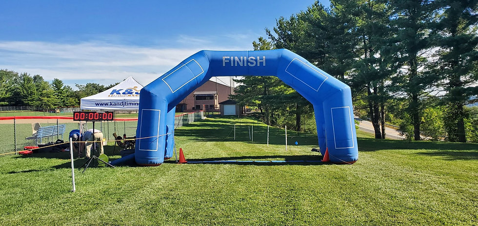 Image of the K&J Timing finishline setup, with branded tent and finish balloon.