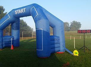 Image of a finish line setup with balloon arch.