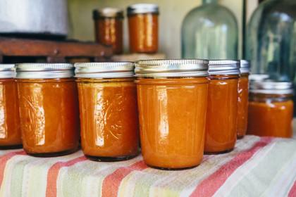 jars-of-peach-jam-on-table-700712027-5a7