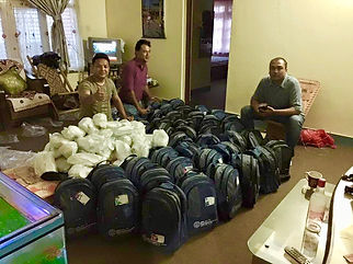 Team members with backpacks and items fo