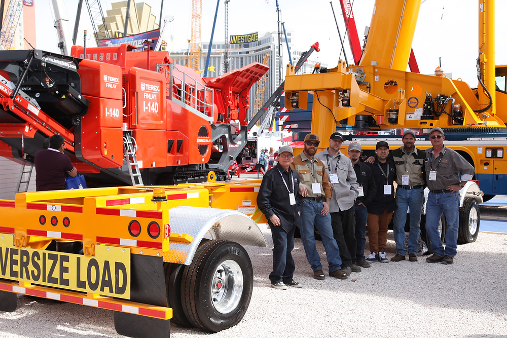 TransWorld Team in front of Terex Demag AC220 and 3-axle California-legal boom dolly