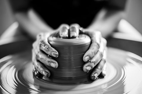 woman potter hands makes on the pottery