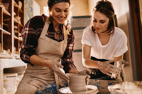 Woman potter teaching the art of pot mak