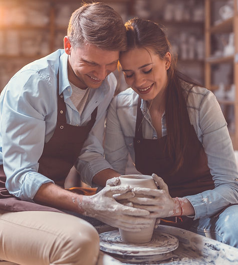 Young couple at artwork in pottery_edite