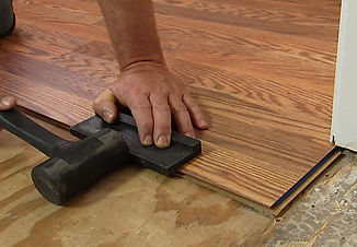 attractive-flooring-installation-install-a-laminate-floor.jpg