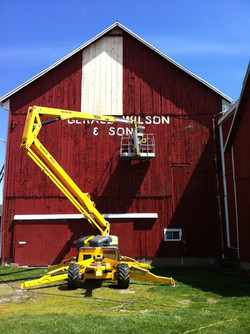 working on barn painting and repair