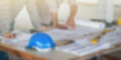 Government Contracts, ERPS Construction Inc., engineer looking over blueprint, construction