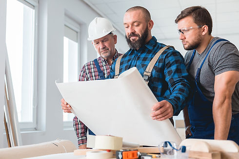 builders-looking-at-the-blueprint-M8PE49