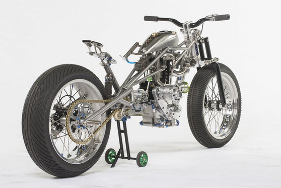 ENGINE: 1935 Triumph L2-1 which has raced in the UK for 70 years FRAME: T45 with 316 stainless steel slugs and Inconel pins which hold it together TRANS: 1965 Japanese grasstrack race box FRONT FORK: Internally sprung 4130 aero tube girder with 316 stainless steel support arms SWINGARM: T45 grasshopper arm with 436 jack shaft running 12 high speed bearings SUPERCHARGER: 1942 Rolls Royce Merlin compressor retrieved from a Spitfire TURBO CHARGER: Extensively re-worked snowmobile unit FUEL TANK: Modifed 1977 Ironhead peanut with internal intercooler, plenum chambers and wastegate plus adjustable inlet tract CARBURETTOR: Yoshimura downdraft IGNITION: SEM magneto OIL TANKS: Also engine cradles, 316 stainless REAR BRAKE: Fully custom with Hope caliper HANDLEBARS: Carbon WHEELS: Supermoto race with Dunlop full wets  Custom build by Rocket Bobs Cycle Works  Photo courtesy of Frank Luger.