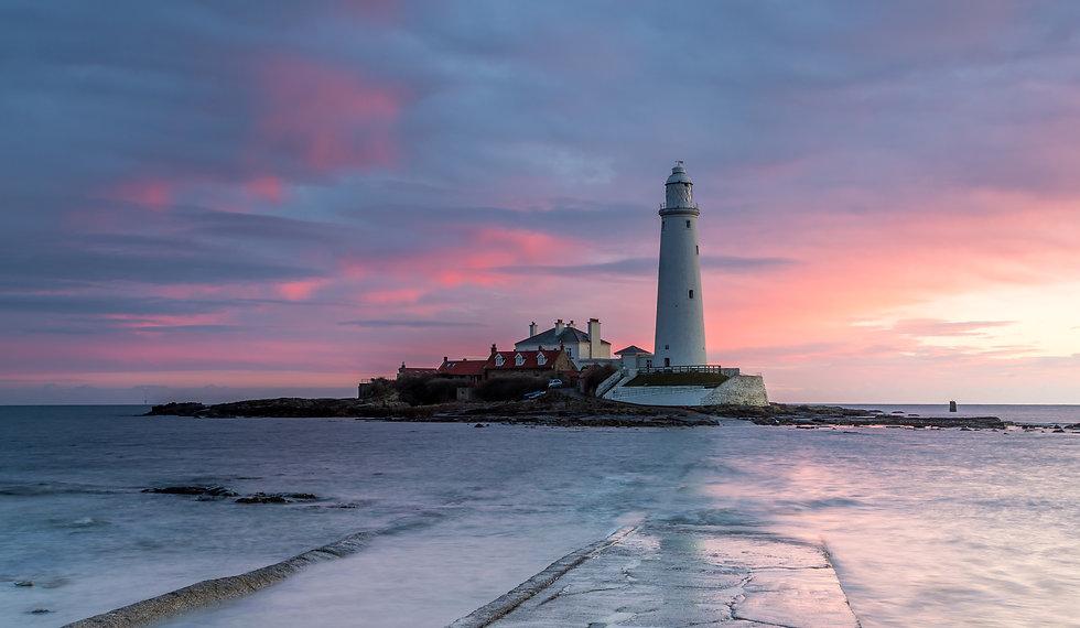 a lighthouse on a bay