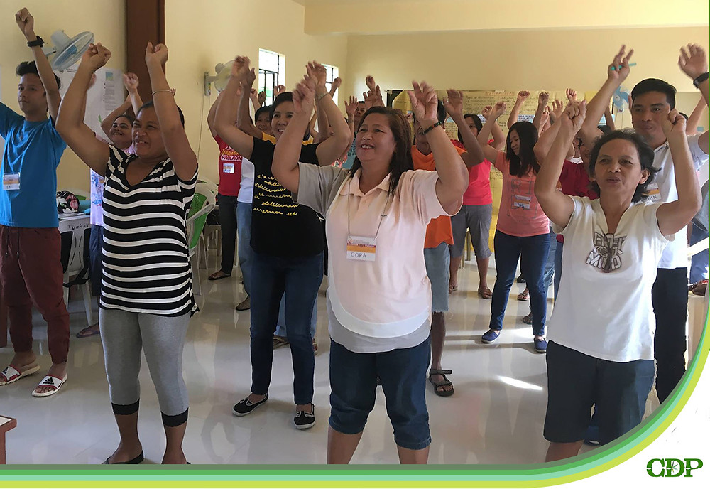 Every morning of the workshop, participants undergo energizing activities to enliven their bodies for a full day's work.