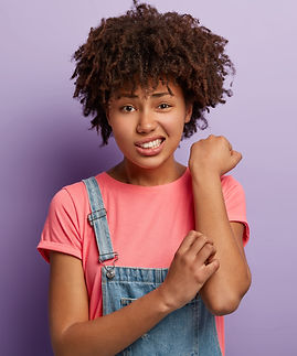 skin-problem-concept-displeased-afro-female-scratches-itchy-arm.jpg