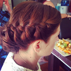 Braided up style with messy bun