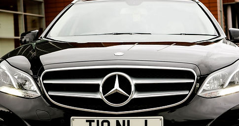 a black mercedes benz e class parked ready for a chauffeur driven transfer