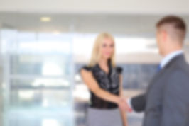 Domino Transfer chauffeur greeing a client at the airport
