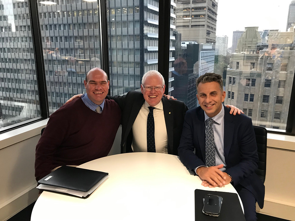 Left to right, photo of Andrew Radford, Gareth Ward and Andrew Constance in Sydney office with city backdrop