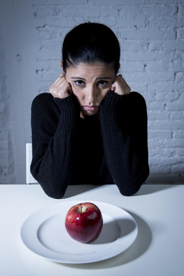 What causes binge eating?