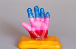 wax hand on a base
