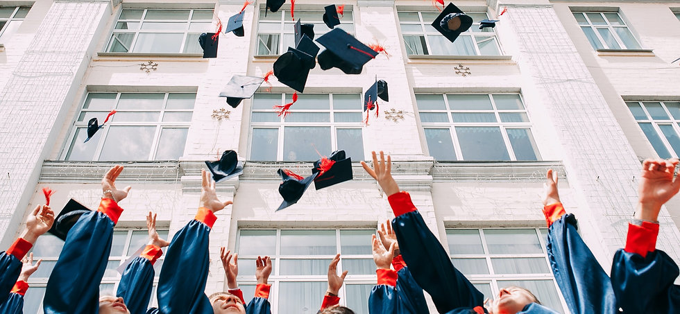 group of fresh graduates students throwing their academic hat in the air_edited.jpg