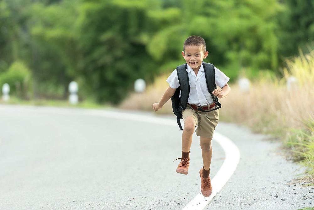 happy child running on street
