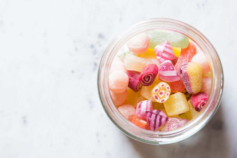large jar of sugary sweets highlighting the impact of too much sugar