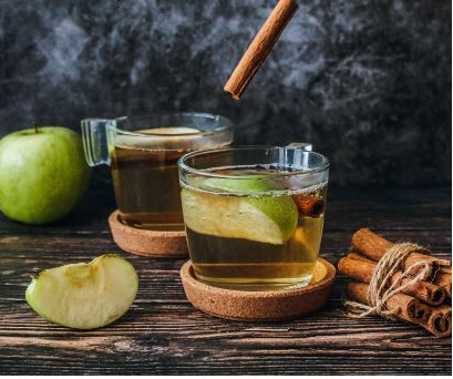 warm winter drink with cinnamon and apple