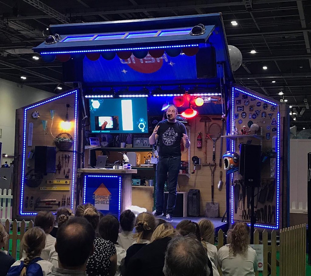 Jamie Gallagher on stage at New Scientist Live