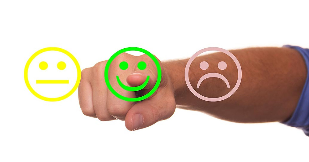 male arm pointing at smiling face for feedback - TripAdvisor fake reviews post