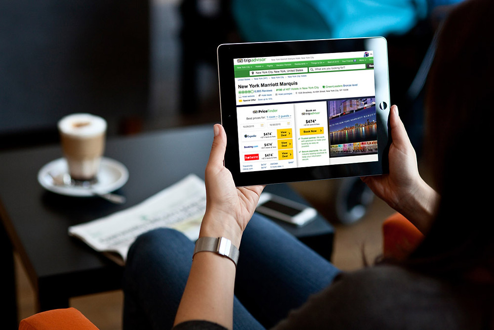 looking at laptop screen with TripAdvisor homepage -  digital reputation management post