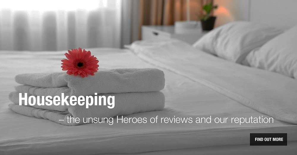 Picture of a made bed commemorating housekeeping appreciation week