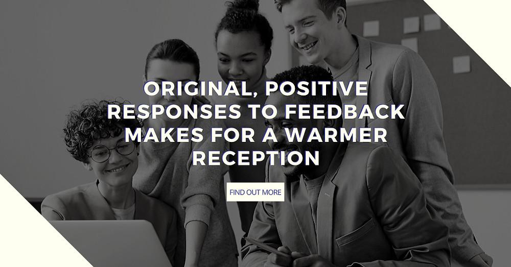 People huddled around laptop - Original positive review response feedback post