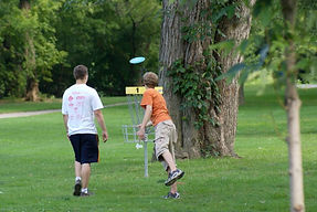 Are the kids playing disc golf again?