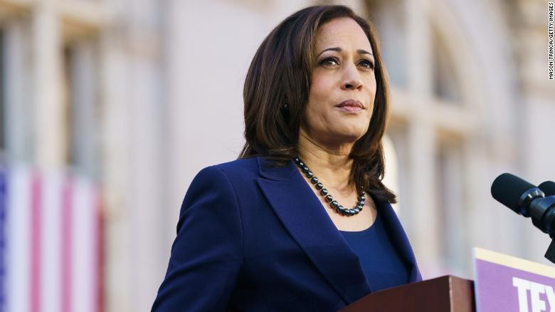 Senator Harris stands at podium
