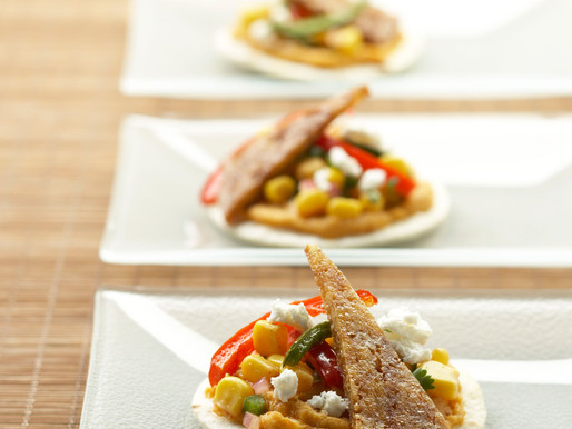 Tostadas of Ancho Spiced Potatoes, Warm Corn Salsa, Fresh Goat Cheese and Tofu Jerky