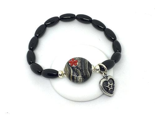 Armband mit Bollenhut aus Glas, Hornoptik