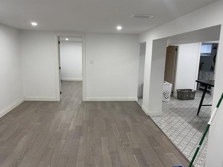 Living room with new Engineered hardwood & water proof underlay