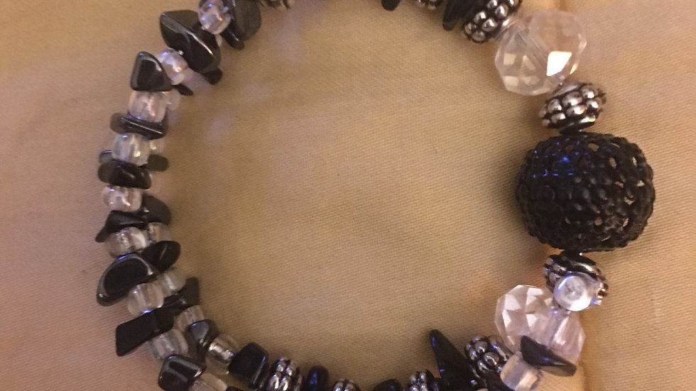clear quarts and obsidian with hematite