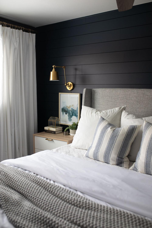 master bedroom makeover dark blue upholstered headboard