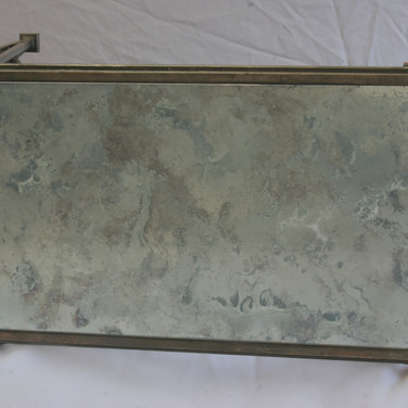 metal table, antique mirror top